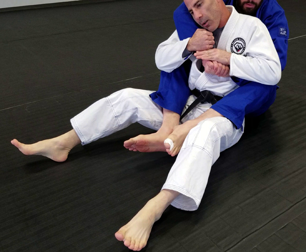 Brazilian Jiu-Jitsu Back Mount with Hooks In Position
